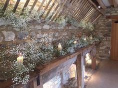 The hay byre filled with gypsophila and storm lanterns #caswellhouse #joannacarterflowers #oxfordshireweddingflowers