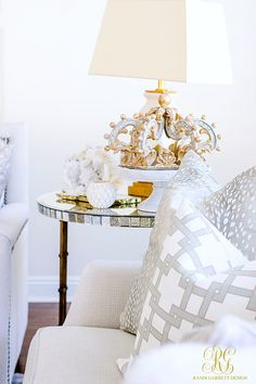 White accessories on mirrored side table in white family room. Spring Home Tour - Randi Garrett Design