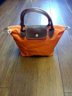 """Longchamp orange """"Le Pliage"""" mini bag #bag #color #le-pliage #leather #longchamp #mini #orange #pliage #purse"""
