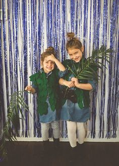 blue foil fringe curtain for a safari photo booth. girls in the jungle. animal party. leaf vests. avatar and wild kingdom party.