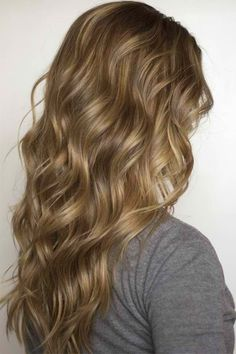 Beautiful, natural highlights on dirty blonde curls - ah! Love.