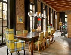Chairs add a touch of yellow to the industrial dining room [Design: Wells &… Feng Shui Dining Table, Dining Room Design, Dining Area, Dining Tables, Dining Rooms, Yellow Dining Room, Yellow Chairs, Wing Chairs, Industrial Dining