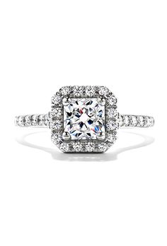 "Brides.com: . ""Transcend Dream"" halo engagement ring, $3,990, Hearts on Fire"