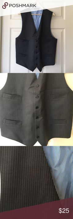 """Men's Gray Pinstripe Suit Vest This vest was used less than a handful of times; it's like-new. Has four chest pockets, six buttons. Lying flat: measures 27"""" L from neck to the tip of the bottom point, 10.5"""" from pit to bottom, and 20"""" across from pit to pit. 100% wool. EUC! No flaws! No trades. Tommy Hilfiger Suits & Blazers Vests"""
