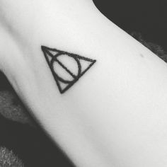 I also got the Deathly Hallows on my wrist because Harry Potter, duh. Now, I realize this is not an original tattoo. And I have thought for years about what to get and I always came back to this. It's simple and clean. When I'm out and about, some potterhead will take notice, show me theirs, and we'll immediately be best friends because we are part of the same fandom. ⚡️ @dabiz36 @bigdeluxetattoo #girlswithtattoos #deathlyhallowstattoo #deathlyhallows #harrypotter #harrypottertattoo