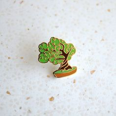 @shinyapplestudio - ✨🚨 New Pin Alert! 🚨✨ My little bonsai tree is here and in the shop ✨🌳✨ No water or sunlight necessary 💛💛💛 #bonsai #bonsaitree #gardener #plants #houseplants #pingame #pingamestrong #pinsofinstagram #pinsofig #pinstagram #pinsforsale #pinsanity #enamelpins #pinmakerssupergroup #enamelpin #lapelpin #flair #flairgame #pincollection #pincollector #pincommunity #tiny #tinythings #miniature