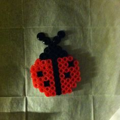 Perler Bead pins/earrings/magnets. $3.00, via Etsy.