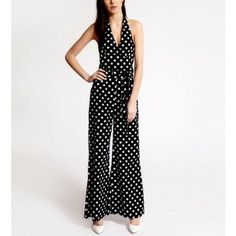 Step into the fashion street with this enchanting black polka dot print jumpsuit.
