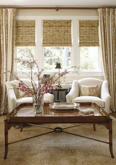 Bamboo matchstick blinds & long draperies accent the white chairs in this casual seating area