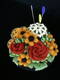 Pin cushion made from felted sweater scraps!  Beautiful!