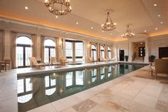 Pool room with custom cabinetry, mouldings, windows. and doors.