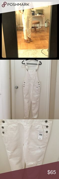"""AG white overalls, semi destroyed, NWT sz. 27 Bought these at a sample sale for $80, tags still on them. But have never gotten around to wearing them! They are so fun and great for Labor Day! Inseam is 26.5"""" but they are longer than that as the straps are adjustable. Any questions let me know! These are a sample. 🛍🤓😘💕 AG Adriano Goldschmied Jeans Overalls"""