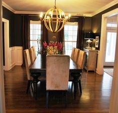 Striking Black Dining room. So often we shy away from black walls. Here is a great example of how it can be done correctly!