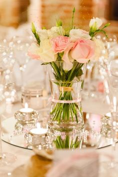 Display glassware, vases of flowers and candles placed on a mirror -lovely reflection- use in bedroom or lounge
