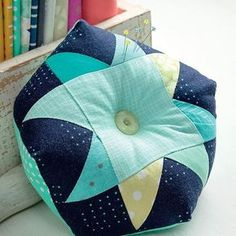 """Sneak peek! This Biscornu Patchwork Pincushion, designed by Adrienne Smitke and featured in the May release Sew Many Gifts, is named for its unique shape - the French word """"biscornu"""" means quirky (in the best way!)."""