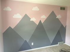 Just finished painting and putting up the clouds in the nursery!!