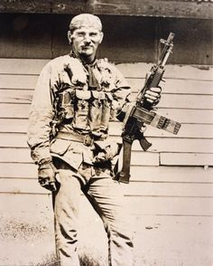 One badass looking Navy SEAL in Vietnam with his Stoner 63a Commando [821x1024]