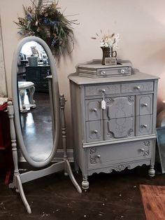 Dresser and mirror done in CeCe Caldwell's French Quarter Gray.  #cececaldwellspaints #diy #paintedfurniture #frenchquartergray #cecepaint #cececaldwells #cececaldwell #betterthanchalk #chalkANDclay