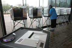 Elva Slade of Hampton casts her vote inside Hampton's City Hall this morning. (Joe Fudge / June 12, 2012)