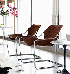 Paulistano armchair, flowers, black and white tables, windows, zebra rug