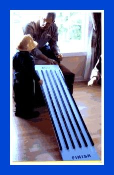 A ramp like this with little matchbox cars for the kids to play with. You could even do a couple of different ramps and have several places to play.