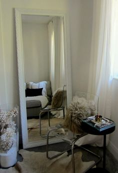 white seating area with Ikea lucite acrylic chair, mongolian fur ...
