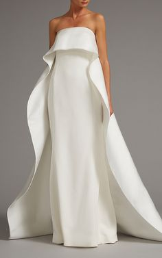 This stunning **Elizabeth Kennedy** bridal gown features an overlay cape detail and a column styled silhouette