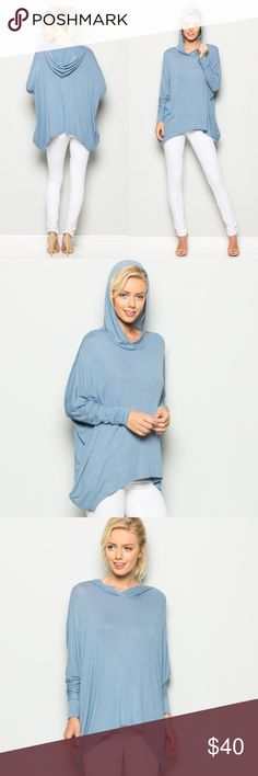 DENIM BLUE HOODIE TUNIC Soft hooded tunic in a cornflower blue. Oversized fit. Asymmetric hem. Side pockets. T-shirt/jersey type material. Tops Tunics
