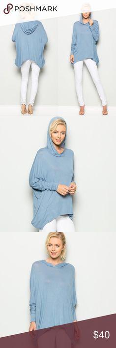 DENIM BLUE HOODIE TUNIC Soft hooded tunic in a cornflower blue. Oversized fit. Asymmetric hem. Side pockets. T-shirt/jersey type material. Tops Tunics