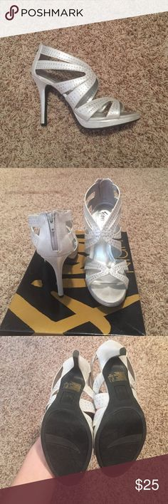 """Strappy silver high heels Worn only once for a wedding. Very pretty! Only one rhinestone missing for both heels! Not noticeable 😊 see last photo. 4"""" heel💖 Reasonable Offers accepted! Fioni NIGHT Shoes Heels"""