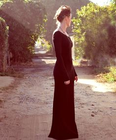 THE SYLVIE FISHTAIL DRESS  $180.00 {via Bona Drag}   Low open back with a dramatic fishtail. Extra long sleeves, and a more modest front neckline. Fabric is a black stretchy cotton lycra. Raw edges. Hand made by With Hearts In My Eyes