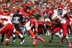 Cincinnati Bengals running back Jeremy Hill (32) stiff-arms Kansas City Chiefs cornerback Marcus Peters (22) on a touchdown run during an NFL football game, Sunday, Oct. 4, 2015, in Cincinnati. (AP Photo/Frank Victores)