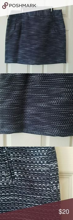 """Ann Taylor Loft outlet skirt Perfect for fall! Can be dressed up or worn casual. Ann Taylor Loft outlet skirt - jacquard - thick woven material with navy liner and back zip. Front pockets are functional, but I never released them so they would stay flat. Navy, grey/silver and white visible in pattern. 19 inches from waist to hem. I am 5'8"""", wore it lower than my waist (not quite on my hips, somewhere between) and it hit just above knee. Non smoking home. A bit of wear on the left hip, shown…"""