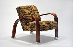 Whiskers Lounge Chair. Steam bent solid American Walnut arms, polished aluminum machined feet, solid maple double doweled seat & back frame with Sinuous springs suspension and multilayer urethane, fire retardant foam. Exposed wood arms are solid American walnut and finished with hand rubbed, multi layer coated lacquer. Upholstery for this contemporary piece is a durable blend of cotton, polyester and rayon with a daring whiskers pattern that compliments the steam bent solid American walnut. American Walnut, Exposed Wood, Compliments, Armchair, Upholstery, Contemporary, The Originals, Frame, Furniture