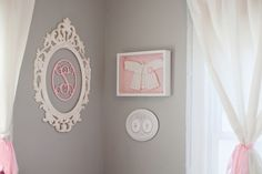 Love the idea of framing special, teeny-tiny newborn clothes after baby outgrows! #DIY #nursery #walldecor