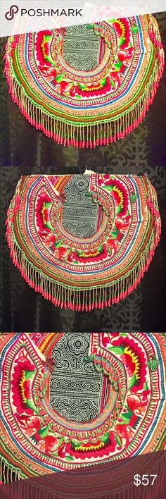 """Hmong Boho Chic Crossbody Bag Vintage Embroidered Hmong Boho Chic Crossbody Bag Vintage Embroidered.BRAND NEW NEVER BEEN USED. VINTAGE HMONG BEADED BAGS/CROSSBODY BOHO BAG Imported from thailand. PATCHES AND BEADS from the Thai Hmong Tribe. Many of the patches are vintage each bag is unique. Beautiful perfect for the spring or summer one of a kind. Fabric is vintage so it has different color """"vintage look"""" ***please not brand Anthropologie only used to display and share**** Anthropologie…"""