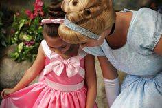 this is one of my most favorite disney photos EVER. this girl takes pictures of her little sister at disneyland, and her mom makes her dresses