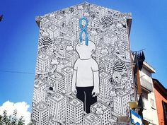 Painting the Town Black and White One neighborhood in Turin gets an artistic make-over by street artist Millo.