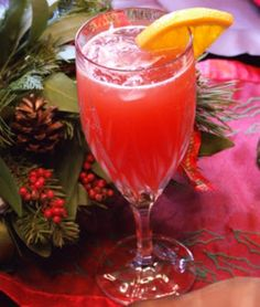 Cranberry Mimosas  4	cups cranberry juice, chilled 4	cups orange juice 2	(750 ml.) bottles Champagne, chilled 12	slices fresh orange, for garnish