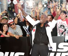 """Cast member Tyrese Gibson poses with fans at the premiere of the new film, """"Fast & Furious 6"""" at Universal Citywalk in Los Angeles May 21, 2013. REUTERS/Fred Prouser"""