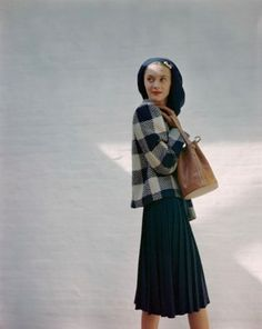 ca. 1946 --- Model wearing navy pleated skirt together with blue-and-white checked jacket from B.H.Wragge. vintage everyday: Extraordinary Color Fashion Photography Taken During the 1940s by John Rawlings