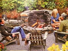 Retaining wall with built in fireplace | Multi-level fire pit built into a retaining wall creates extra seating ...