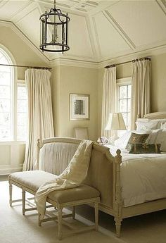 Neutral French country bedroom.                              …