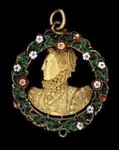 '' Phoenix '' Jewel - Gold pendant, bust of Queen Elizabeth I cut out in silhouette; on the reverse, in relief, the device of a Phoenix in flames under the royal monogram, crown and heavenly rays; enclosed within an enamelled wreath of red and white Tudor roses with green leaves and intertwined stalks.  1570-1580 (circa) Made in England   gold term details  enamel  enamelled - H 49 millimetres (without loop)