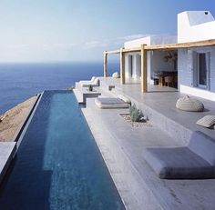 This stunning Mediterranean house is located on the Greek island of Syros. Designed by (an architecture and interior design studio based in Athens, Greece) this summer house was adapted to the steep, dramatic topography and is position Myconos, Outdoor Fireplace Designs, Villa, Greek House, Dream Pools, Mediterranean Homes, Summer Dream, Cool Pools, Interior Design Studio