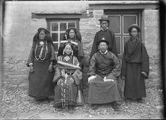 Lepcha, Collection: Sir Charles Bell, Date of Photo: September 1920? Named Person: Doring Kusho, Doring Kusho's wife, RegionGyantse Region, Doring House. The Wife with turquoise ear-rings, a 'gau' (amulet box) at her neck.