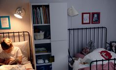 IKEA STUVA storage combination used as a divider between two beds - a good idea for different sleeping times