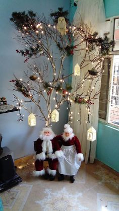 sant ans Santa sitting under lovely Christmas tree decor with lights and lamps Beautiful Christmas Decorations, Indoor Christmas Decorations, Outdoor Christmas, Diy Christmas Gifts, Christmas Home, Christmas Wreaths, Christmas Branches, 242, Christmas Design