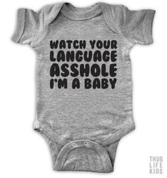 Watch your language asshole, I'm a baby! White Onesies are 100% cotton. Heather Grey Onesies are 90% cotton, 10% polyester. All shirts are printed in the USA