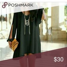 Dress This beautiful black mini dress some call a shirt dress. There's a slit from shoulder to wrist or peekboo sleeve. Ive included a lin silver chain as well Dresses Mini